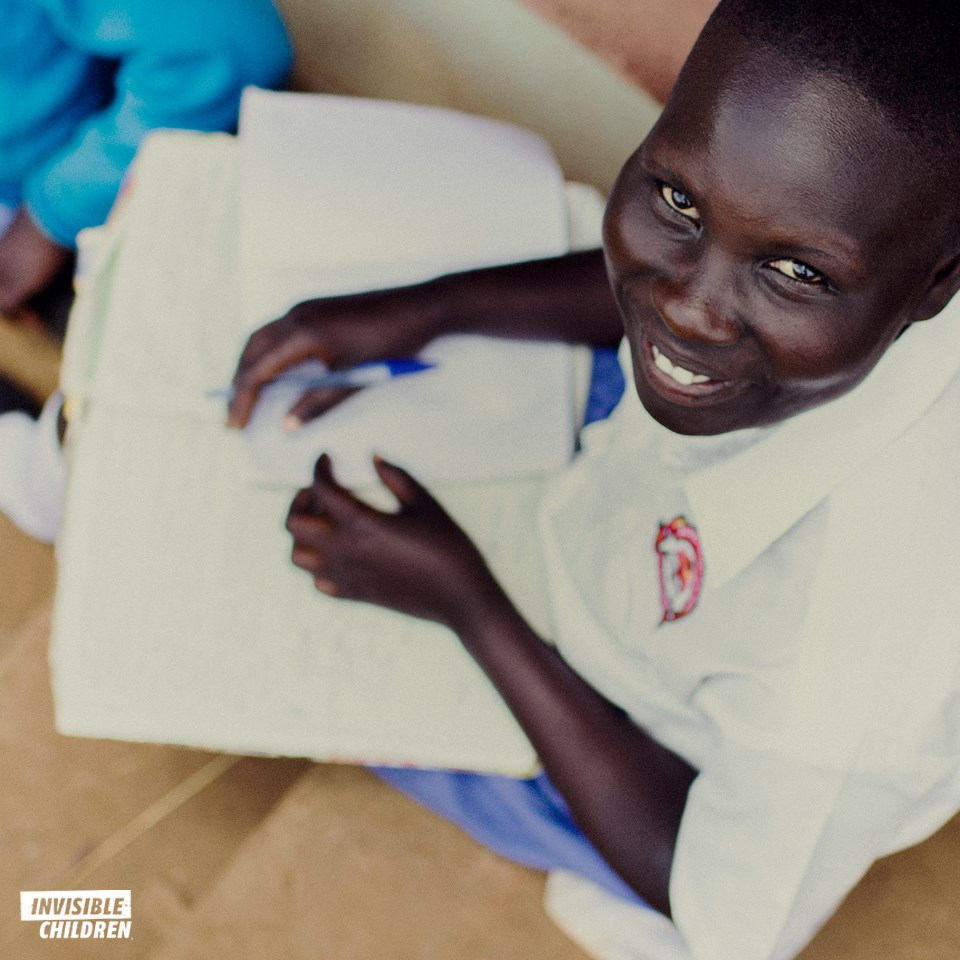 Image of smiling African boy at school