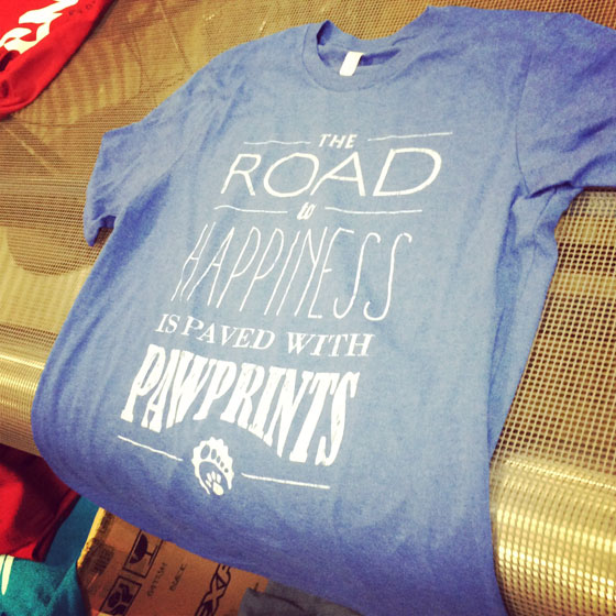 The Road to Happiness is Paved with Pawprints T-Shirt Design | Wisconsin Humane Society