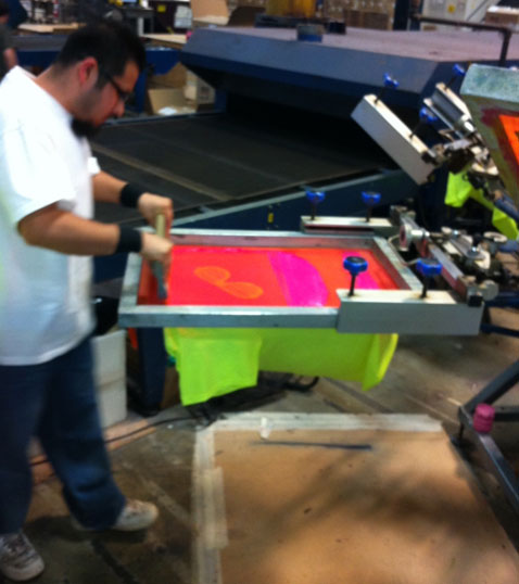 Juan printing the first INK shirt